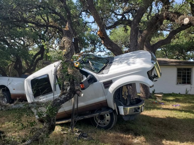 Guy tries to remove his Super Duty Cab using a tree limb