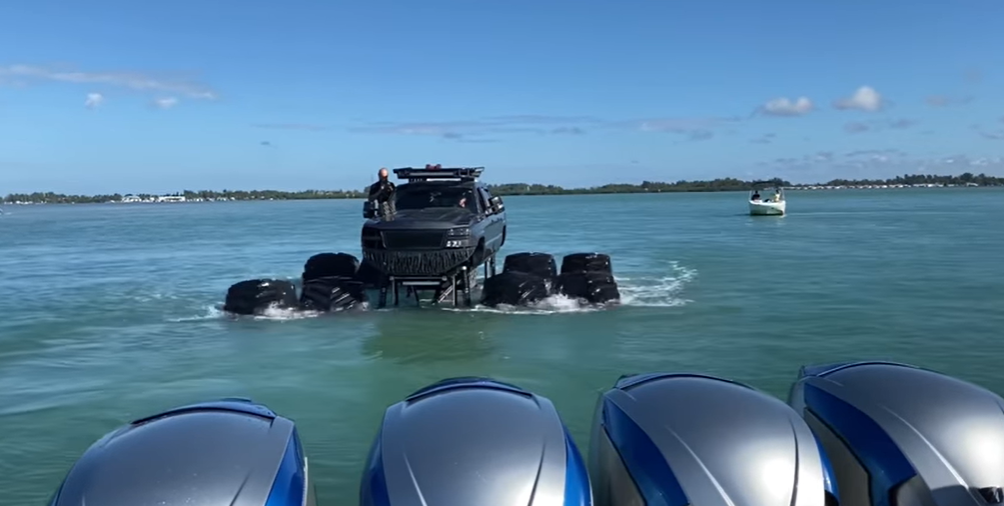 Whistlindiesel drives his Monster Max truck into the Gulf of Mexico