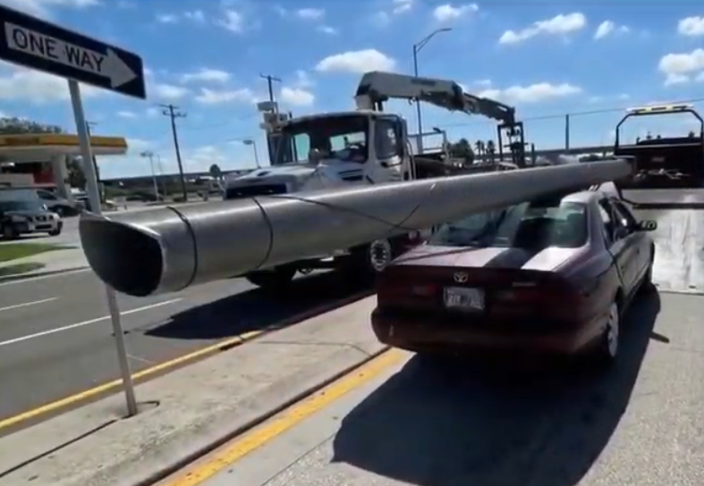 A scrapper strapped a utility pole to his 97 Toyota Camry