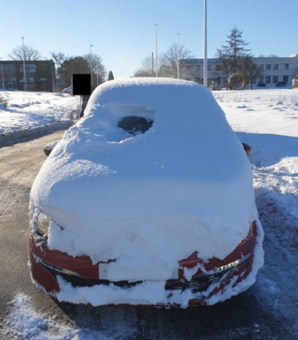 A man was pulled over for driving in a snow covered car