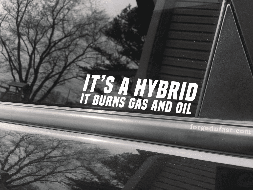 it s a hybrid it burns gas and oil sticker