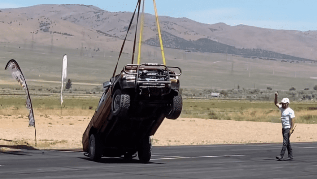 Toyota Hilux lifted by helicopter